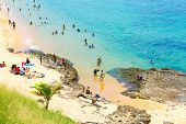 BAHIA, BRAZIL - CIRCA NOV 2014: People enjoy a sunny day at Boa Viagem Beach in Bahia, Brazil.