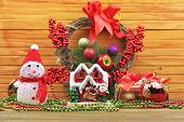 Christmas Toy Balls With Snowman, Berries, Gifts, Beads, Toy Home On Wooden Background. Christmas De