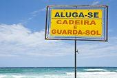 Rent sign for beach chair and beach umbrela.