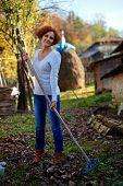 Farmer Lady Raking, Cleaning The Garden