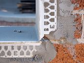 Cement render and brickwork detail on a building site