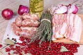 Red beans, thyme, sausages and bacon