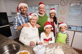 Multi-generation family baking together at home in the kitchen