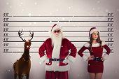 Santa Claus wears black sunglasses against mug shot background