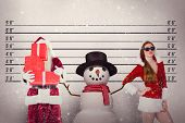Santa covers his face with presents against mug shot background