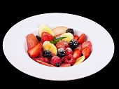 Fruit and berry salad isolated on a black background