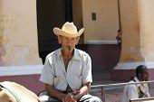 Old Man Smoking A Cuban Cigar