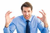 Annoyed businessman raising his hands on white background