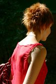 Red-haired girl in red