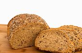 foto of sesame seed  - Wholemeal bread slice with poppy sunflower and sesame seeds on a bread broad with copy space