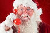 Santa on his red phone against red background