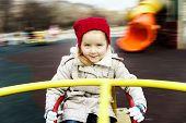 Cute Little Girl Rounding On Merry-go-round