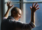 picture of hospital gown  - Bald woman suffering from cancer leaning on the hospital window - JPG