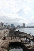 People bathing on Havana Malecon
