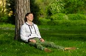 Happy Young Man Relaxing In The Park