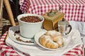 Retro Coffee Composition - Grinder, Coffee Seeds, Cakes, Cup On Table