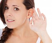 stock photo of scandinavian descent  - Young woman has trouble to hear something - JPG