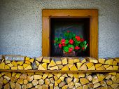 Window And Chopped Wood