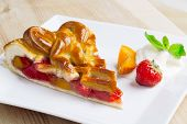 image of apricot  - Apricot and strawberry pie on a plate - JPG