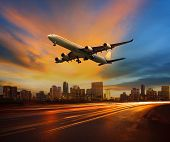 Beautiful Lighting Of Vehicle In Land Transportation And Passenger Jet Plane Flying Above Urban Scen