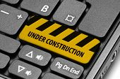 Under Construction. Yellow Warning Key On Computer Keyboard