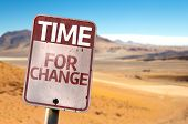Time For Change sign with a desert background