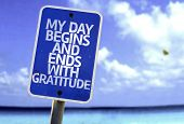 My Day Begins and Ends With Gratitude sign with a beach on background