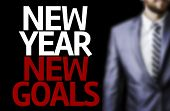 Business man with the text Great Ideas New Year New Goals in a concept image