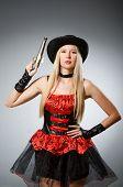 Woman pirate with gun wearing hat