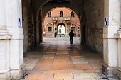 Pedestrian Under The Arch At Piazza Della Signoria In Verona, Italy