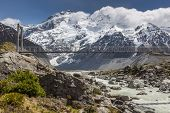 stock photo of hooker  - Bridge over Hooker River in Aoraki national park New Zealand