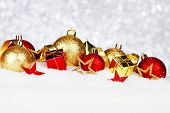 Christmas card with beautiful red and golden decorations in snow