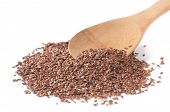 Flax Seeds With A Wooden Spoon On White Background