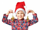 Little Boy In Red Santa Hat With Golden Stars