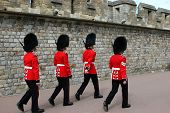 picture of guardsmen  - the queens famous scots guardsmen in full red uniform mrching - JPG