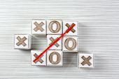 Game of Tic Tac Toe on wooden background