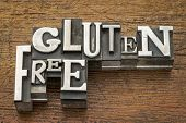 gluten free words  in vintage metal type printing blocks over grunge wood - nutrition concept
