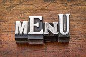 menu word in vintage metal type printing blocks over grunge wood
