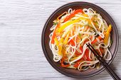 picture of chopsticks  - Rice noodles with vegetables close - JPG