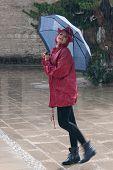 Young Woman Walking In The Rain