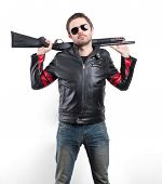 picture of shotgun  - Man in black leather jacket and sunglasses with shotgun - JPG