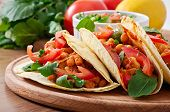 stock photo of pepper  - Mexican Tacos with chicken and bell peppers - JPG