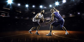 picture of slam  - Two basketball players in action in gym in lights - JPG