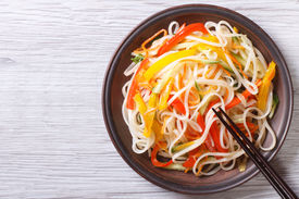 stock photo of noodles  - Rice noodles with vegetables close - JPG