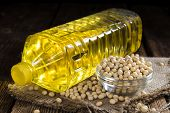 picture of soya beans  - Bottle of Soy Oil on dark rustic wooden background - JPG
