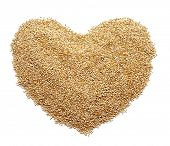 picture of quinoa  - a pile of quinoa seeds forming a heart on a white background - JPG