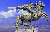 foto of horse-riders  - Bronze sculpture of a rider and his war horse on the