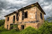 picture of abandoned house  - Image of an old abandoned house in the storm - JPG