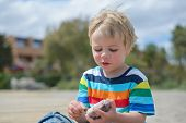 image of little boys only  - Portrait of happy little boy in multicolored t - JPG
