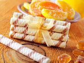 stock photo of sticks  - wafer sticks on wooden table - JPG